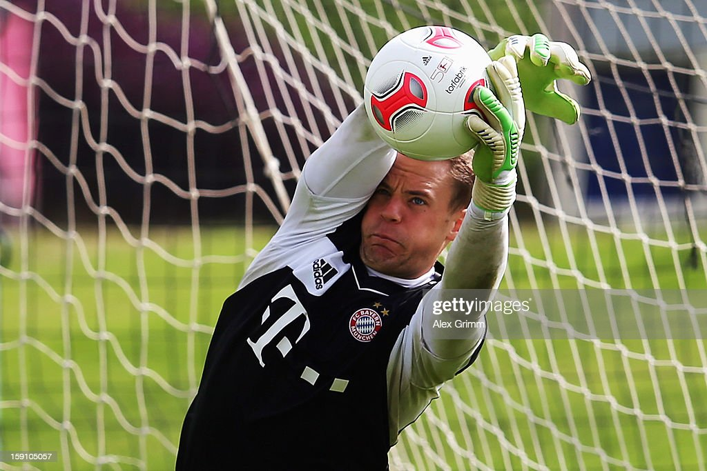 Goalkeeper <a gi-track='captionPersonalityLinkClicked' href=/galleries/search?phrase=Manuel+Neuer&family=editorial&specificpeople=764621 ng-click='$event.stopPropagation()'>Manuel Neuer</a> catches a ball during a Bayern Muenchen training session at the ASPIRE Academy for Sports Excellence on January 8, 2013 in Doha, Qatar.