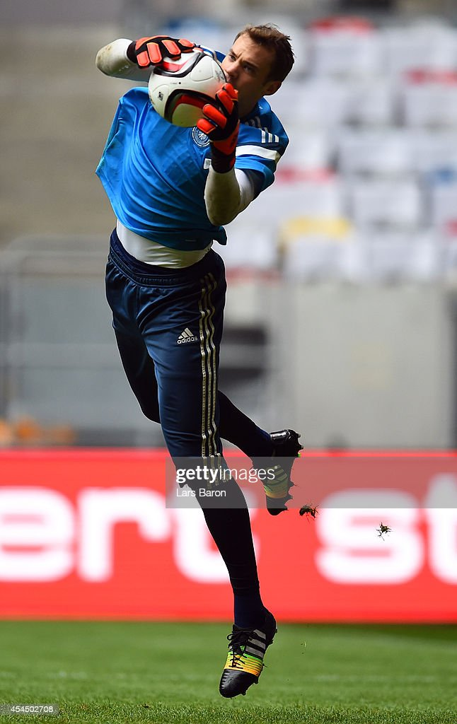 Goalkeeper <a gi-track='captionPersonalityLinkClicked' href=/galleries/search?phrase=Manuel+Neuer&family=editorial&specificpeople=764621 ng-click='$event.stopPropagation()'>Manuel Neuer</a> catches the ball during a Germany training session at Esprit Arena on September 2, 2014 in Duesseldorf, Germany.