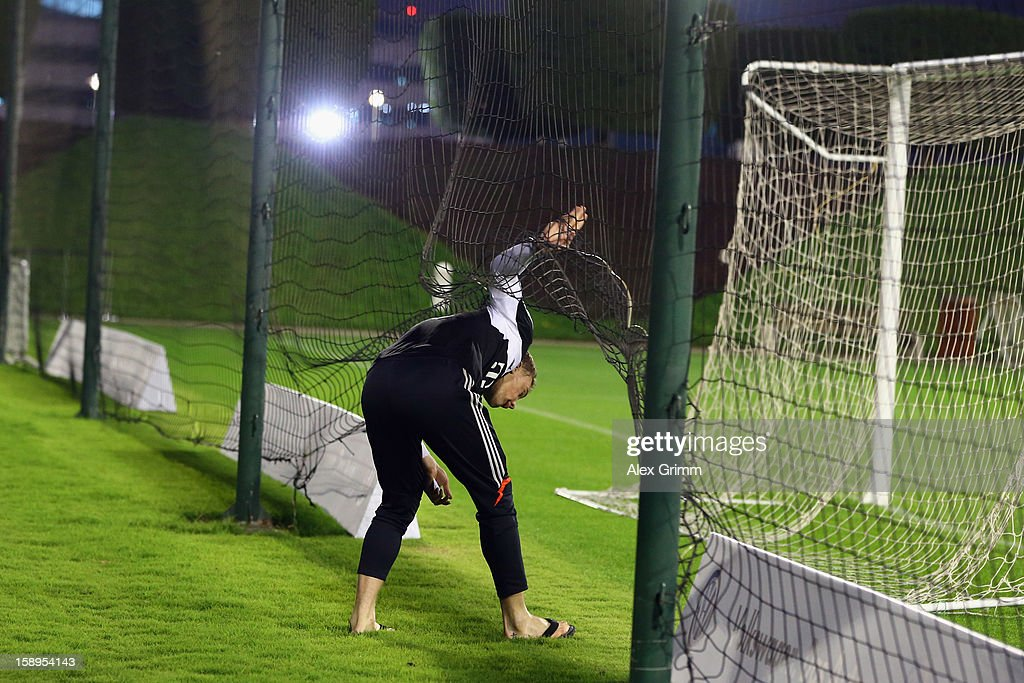Goalkeeper <a gi-track='captionPersonalityLinkClicked' href=/galleries/search?phrase=Manuel+Neuer&family=editorial&specificpeople=764621 ng-click='$event.stopPropagation()'>Manuel Neuer</a> enters the pitch for a Bayern Muenchen training session at the ASPIRE Academy for Sports Excellence on January 4, 2013 in Doha, Qatar.