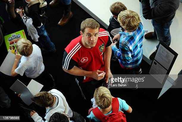 Goalkeeper Manuel Neuer gives autographs after a Germany press conference on October 9 2011 in Duesseldorf Germany