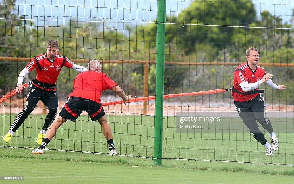 Goalkeeper <a gi-track='captionPersonalityLinkClicked' href=/galleries/search?phrase=Manuel+Neuer&family=editorial&specificpeople=764621 ng-click='$event.stopPropagation()'>Manuel Neuer</a> (R) in action during the German National team training at Campo Bahia on June 14, 2014 in Santo Andre, Brazil.