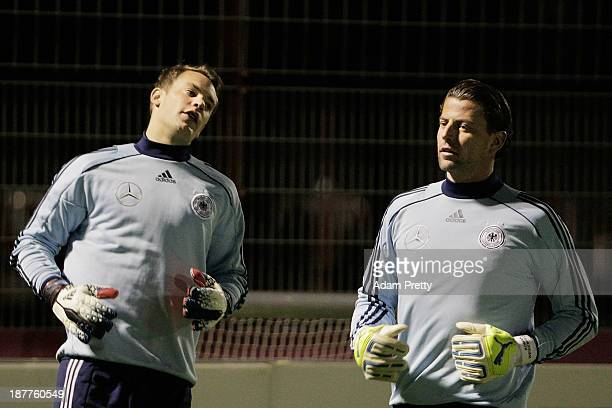 Goalkeeper Manuel Neuer keeps an eye on Roman Weidenfeller of Germany during training at the Bayern Munich Training Ground on November 12 2013 in...