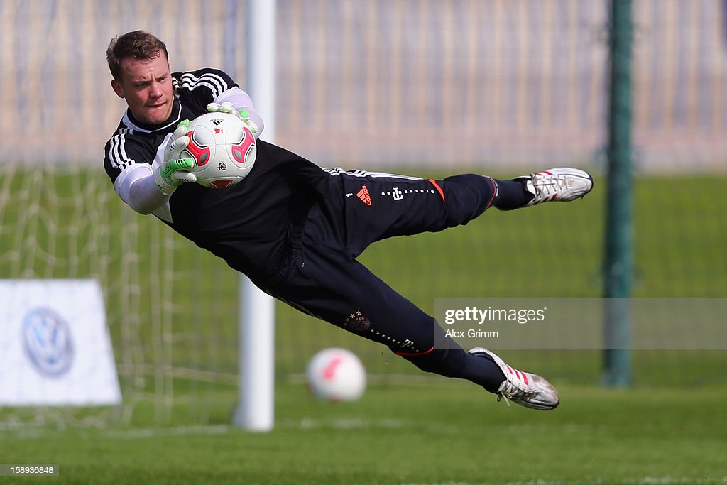 Goalkeeper <a gi-track='captionPersonalityLinkClicked' href=/galleries/search?phrase=Manuel+Neuer&family=editorial&specificpeople=764621 ng-click='$event.stopPropagation()'>Manuel Neuer</a> makes a save during a Bayern Muenchen training session at the ASPIRE Academy for Sports Excellence on January 4, 2013 in Doha, Qatar.