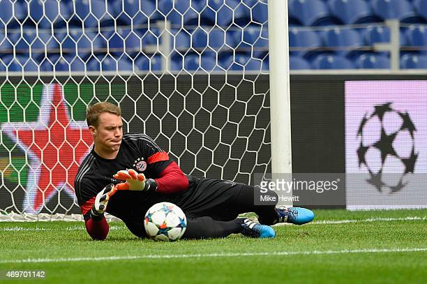Goalkeeper Manuel Neuer makes a save during a FC Bayern Muenchen Training Session ahead of the UEFA Champions League QuarterFinal First Leg match...