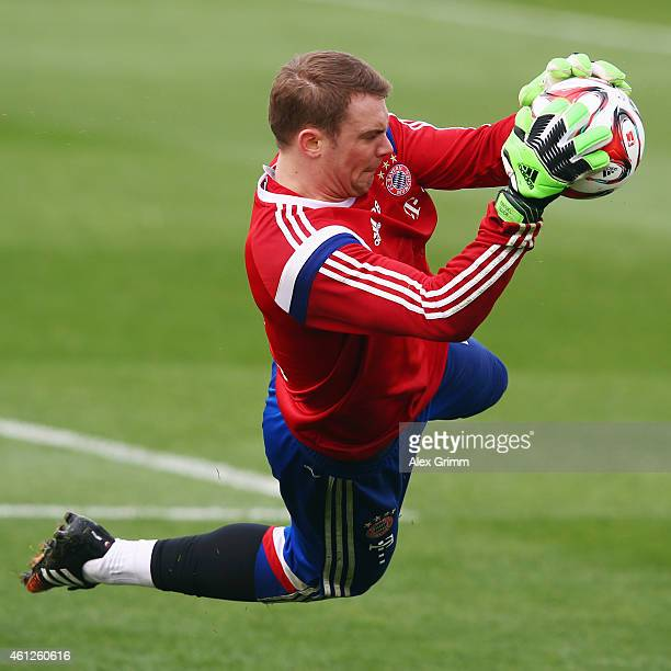 Goalkeeper Manuel Neuer makes a save during day 2 of the Bayern Muenchen training camp at ASPIRE Academy for Sports Excellence on January 10 2015 in...