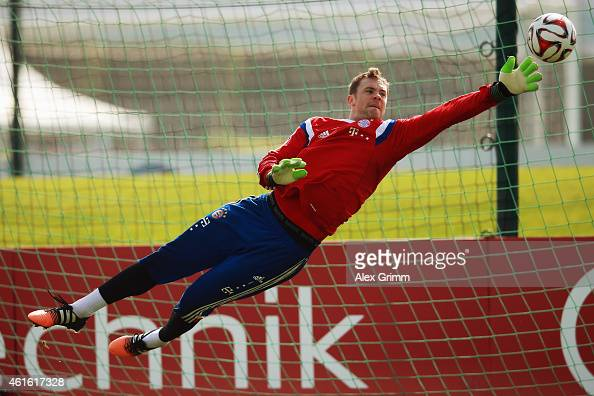 Goalkeeper Manuel Neuer makes a save during day 8 of the Bayern Muenchen training camp at ASPIRE Academy for Sports Excellence on January 16 2015 in...