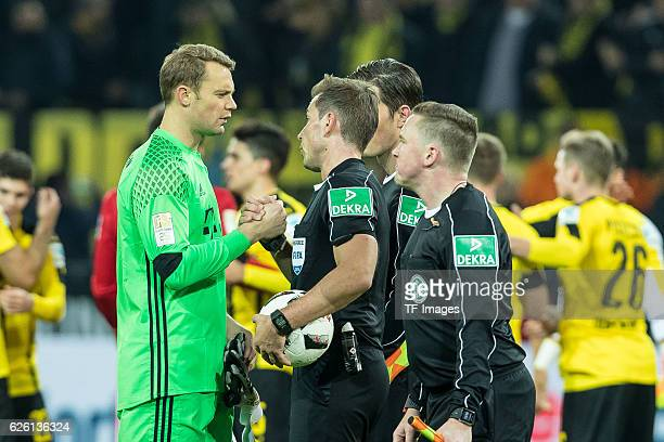 goalkeeper Manuel Neuer of Bayern Muenchen and referee Tobias Stieler looks on during the Bandesliga soccer match between BV Borussia Dortmund and FC...