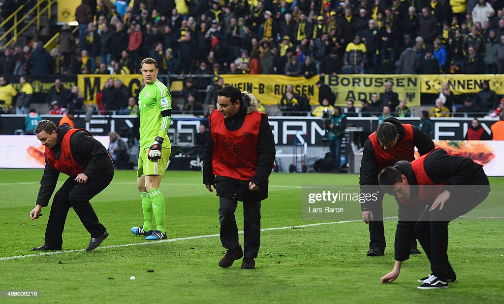 Goalkeeper Manuel Neuer of Bayern Muenchen gets help by stewards during the Bundesliga match between Borussia Dortmund and FC Bayern Muenchen at...