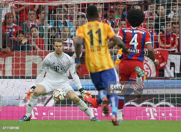 Goalkeeper Manuel Neuer of Bayern Muenchen is about to save a shot of Salomon Kalou of Hertha BSC during the Bundesliga match between FC Bayern...