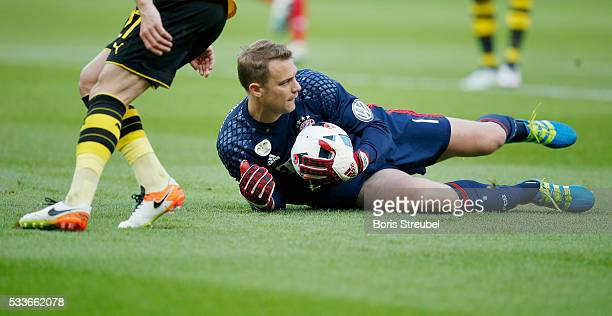 Goalkeeper Manuel Neuer of Bayern Muenchen saves the ball during the DFB Cup Final match 2016 between Bayern Muenchen and Borussia Dortmund at...