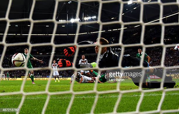 Goalkeeper Manuel Neuer of Germany dives in vain as John O'Shea of the Republic of Ireland scores an injury time goal to level the scores at 11...