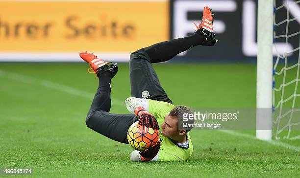 Goalkeeper Manuel Neuer of Germany jumps for a ball during a Germany training session ahead of their International Friendly against France at Stade...
