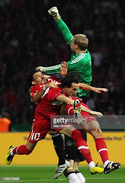 Goalkeeper Manuel Neuer of Germany jumps for the ball with team mate Per Mertesacker Tuncay Sanli and Servet Cetin of Turkey during the EURO 2012...