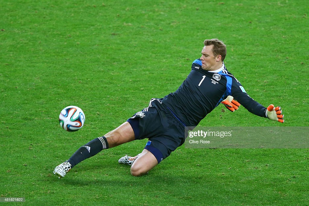 Goalkeeper <a gi-track='captionPersonalityLinkClicked' href=/galleries/search?phrase=Manuel+Neuer&family=editorial&specificpeople=764621 ng-click='$event.stopPropagation()'>Manuel Neuer</a> of Germany makes a save during the 2014 FIFA World Cup Brazil Round of 16 match between Germany and Algeria at Estadio Beira-Rio on June 30, 2014 in Porto Alegre, Brazil.
