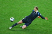 Goalkeeper Manuel Neuer of Germany makes a save during the 2014 FIFA World Cup Brazil Round of 16 match between Germany and Algeria at Estadio...