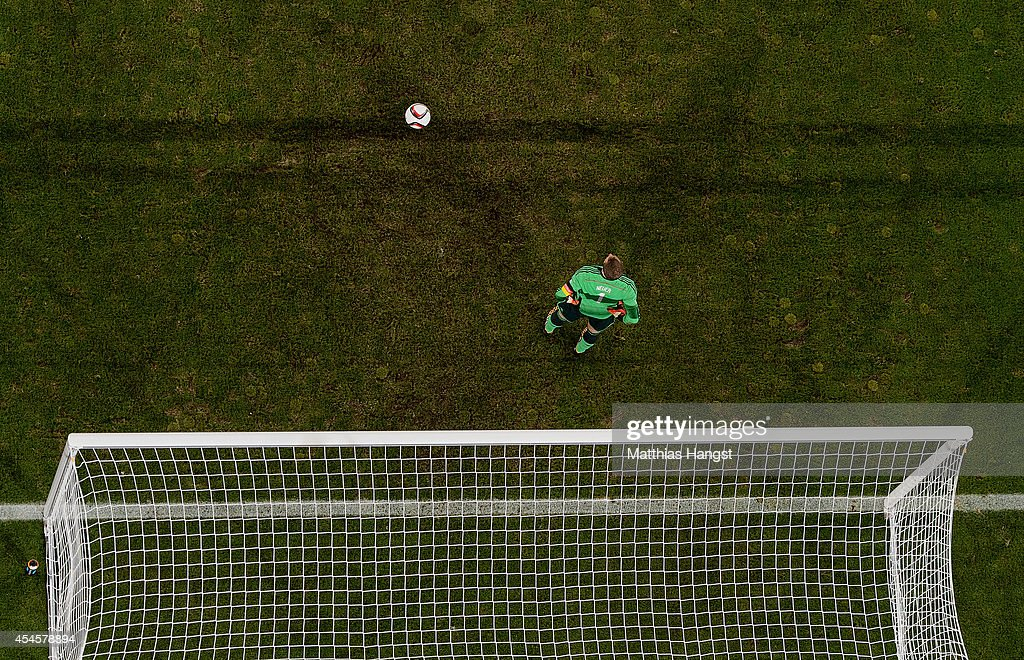Goalkeeper <a gi-track='captionPersonalityLinkClicked' href=/galleries/search?phrase=Manuel+Neuer&family=editorial&specificpeople=764621 ng-click='$event.stopPropagation()'>Manuel Neuer</a> of Germany reacts after a goal during the international friendly match between Germany and Argentina at Esprit-Arena on September 3, 2014 in Duesseldorf, Germany.
