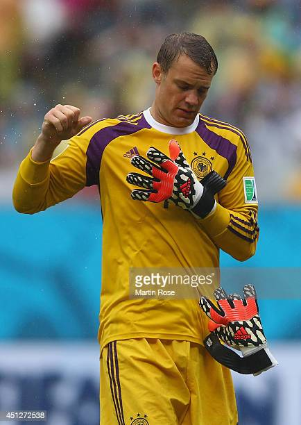 Goalkeeper Manuel Neuer of Germany removes his gloves at the half during the 2014 FIFA World Cup Brazil group G match between the United States and...