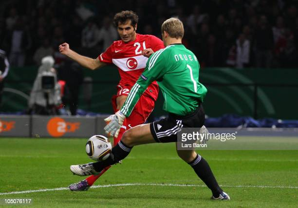 Goalkeeper Manuel Neuer of Germany saves a shoot of Halil Altintop of Turkey during the EURO 2012 Group A qualifier match between Germany and Turkey...