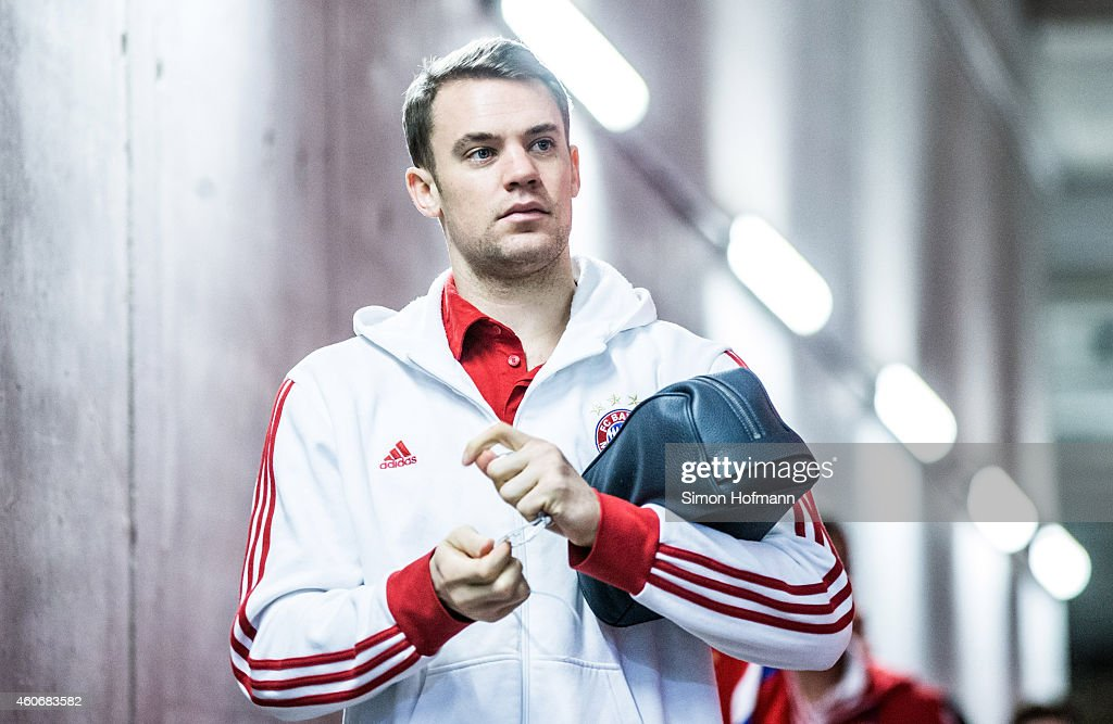 Goalkeeper <a gi-track='captionPersonalityLinkClicked' href=/galleries/search?phrase=Manuel+Neuer&family=editorial&specificpeople=764621 ng-click='$event.stopPropagation()'>Manuel Neuer</a> of Muenchen arrives prior to the Bundesliga match between 1. FSV Mainz 05 and FC Bayern Muenchen at Coface Arena on December 19, 2014 in Mainz, Germany.