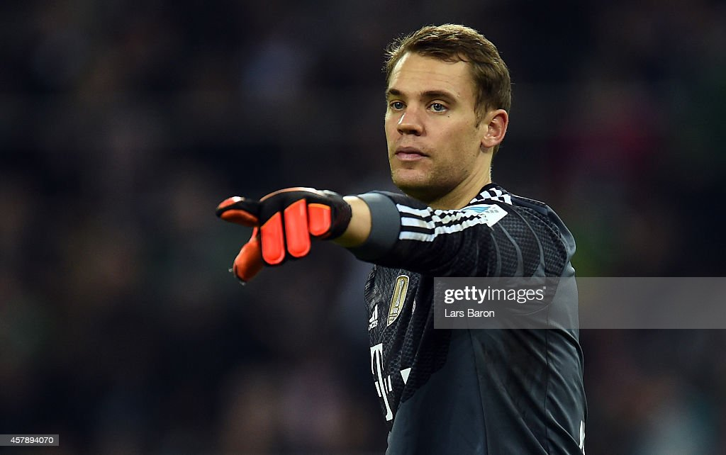 Goalkeeper <a gi-track='captionPersonalityLinkClicked' href=/galleries/search?phrase=Manuel+Neuer&family=editorial&specificpeople=764621 ng-click='$event.stopPropagation()'>Manuel Neuer</a> of Muenchen gestures during the Bundesliga match between Borussia Moenchengladbach and FC Bayern Muenchen at Borussia Park on October 26, 2014 in Moenchengladbach, Germany.