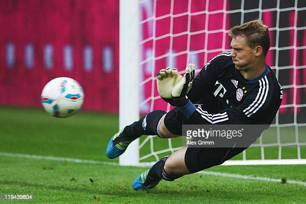 Goalkeeper Manuel Neuer of Muenchen makes a save during the penalty shootout during the LIGA total Cup 3rd place match between FSV Mainz 05 and...