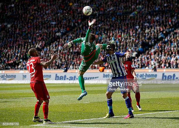 Goalkeeper Manuel Neuer of Muenchen saves a ball of Vedad Ibisevic of Berlin during the Bundesliga match between Hertha BSC and FC Bayern Muenchen at...