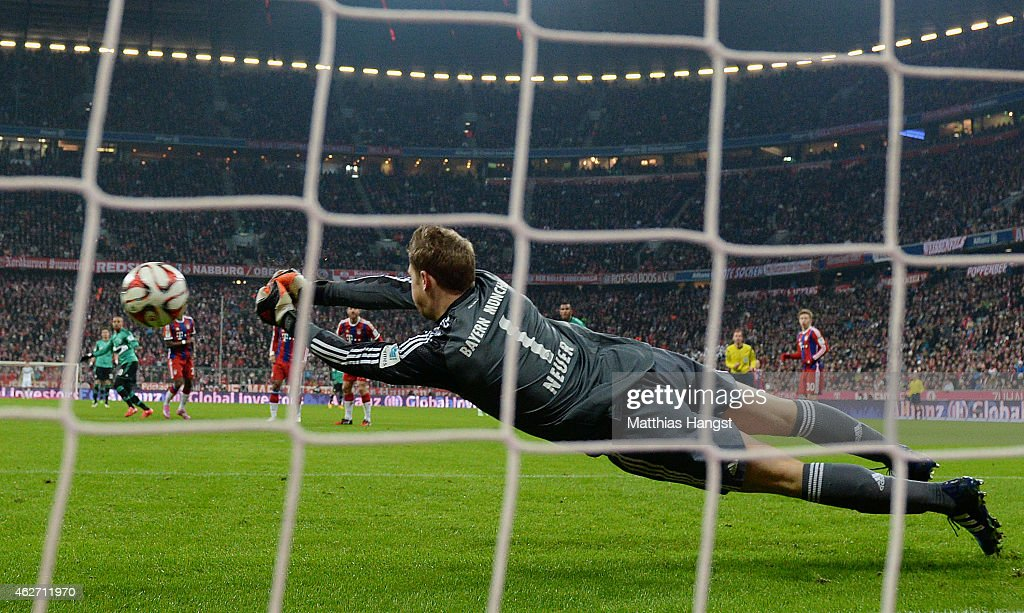 Goalkeeper <a gi-track='captionPersonalityLinkClicked' href=/galleries/search?phrase=Manuel+Neuer&family=editorial&specificpeople=764621 ng-click='$event.stopPropagation()'>Manuel Neuer</a> of Muenchen saves a penalty of Eric Maxim Choupo-Moting of Schalke during the Bundesliga match between FC Bayern Muenchen and FC Schalke 04 at Allianz Arena on February 3, 2015 in Munich, Germany.