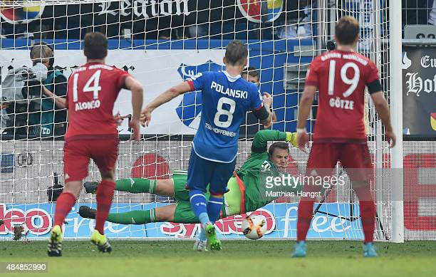 Goalkeeper Manuel Neuer of Muenchen saves a penalty of Eugen Polanski of Hoffenheim during the Bundesliga match between 1899 Hoffenheim and FC Bayern...