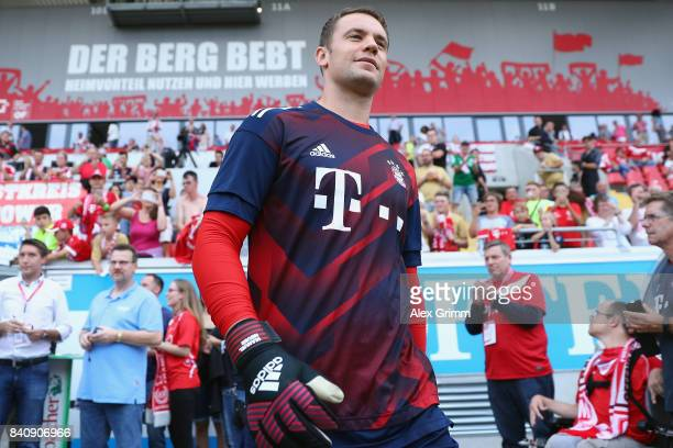 Goalkeeper Manuel Neuer of Muenchen walks out to warm up for a friendly match between Kickers Offenbach and FC Bayern Muenchen at...
