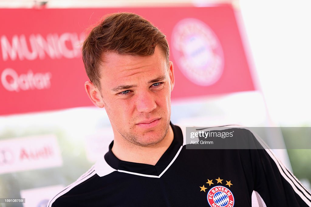 Goalkeeper <a gi-track='captionPersonalityLinkClicked' href=/galleries/search?phrase=Manuel+Neuer&family=editorial&specificpeople=764621 ng-click='$event.stopPropagation()'>Manuel Neuer</a> pauses during a Bayern Muenchen press conference at the Grand Heritage Hotel on January 8, 2013 in Doha, Qatar.