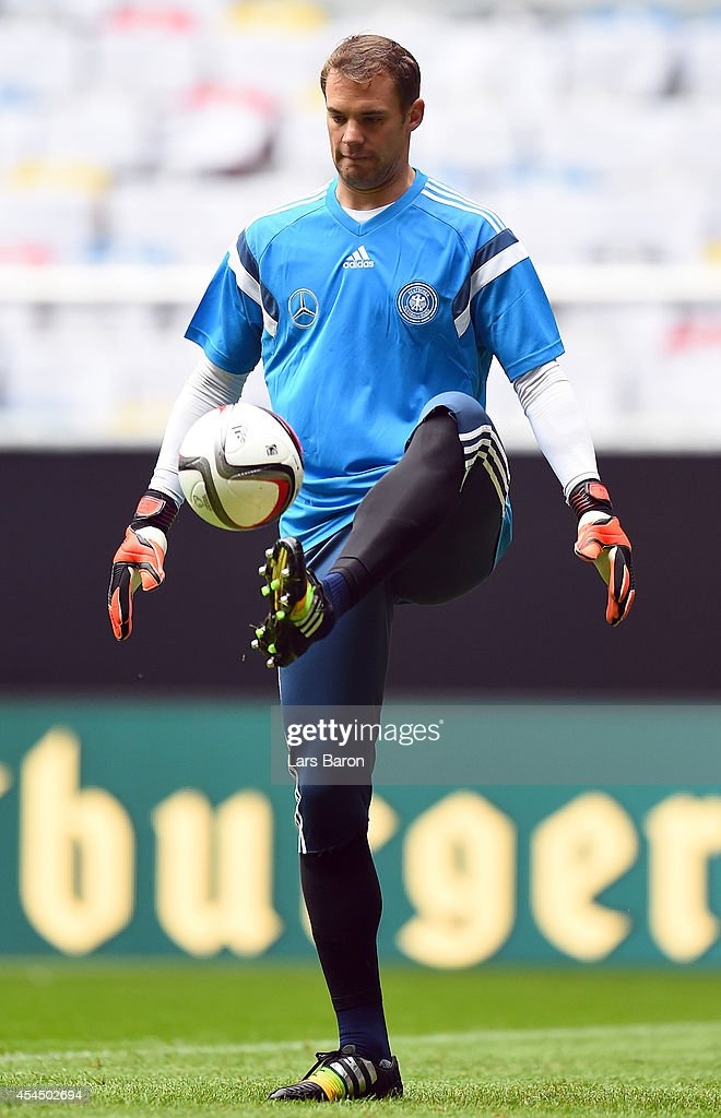 Goalkeeper <a gi-track='captionPersonalityLinkClicked' href=/galleries/search?phrase=Manuel+Neuer&family=editorial&specificpeople=764621 ng-click='$event.stopPropagation()'>Manuel Neuer</a> plays with the ball during a Germany training session at Esprit Arena on September 2, 2014 in Duesseldorf, Germany.