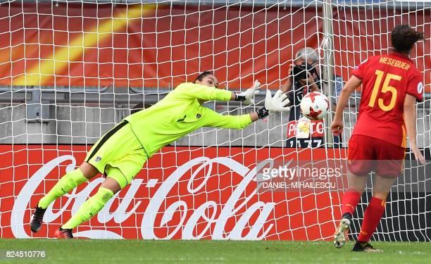 Goalkeeper Manuela Zinsberger of Austria stops a penalty kick by Silvia Meseguer of Spain during the UEFA Womens Euro 2017 quarterfinal football...