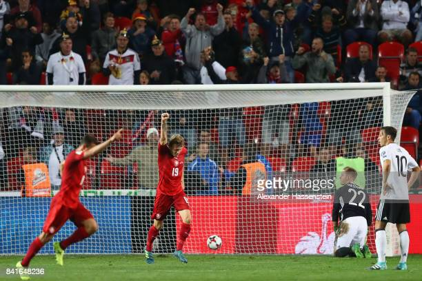 Goalkeeper MarcAndre ter Stegen and Mesut Oezil of Germany react after Vladimir Darida of Czech Republic scored his team's first goal during the FIFA...