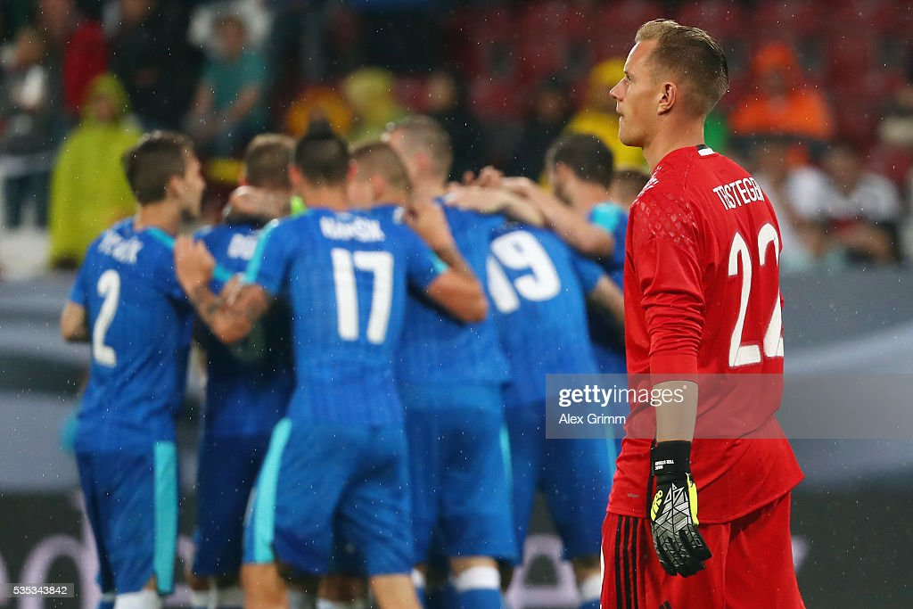 Goalkeeper <a gi-track='captionPersonalityLinkClicked' href=/galleries/search?phrase=Marc-Andre+ter+Stegen&family=editorial&specificpeople=5528638 ng-click='$event.stopPropagation()'>Marc-Andre ter Stegen</a> of Germany reacts as Juray Kucka of Slovakia celebrates his team's third goal with team mates during the international friendly match between Germany and Slovakia at WWK-Arena on May 29, 2016 in Augsburg, Germany.