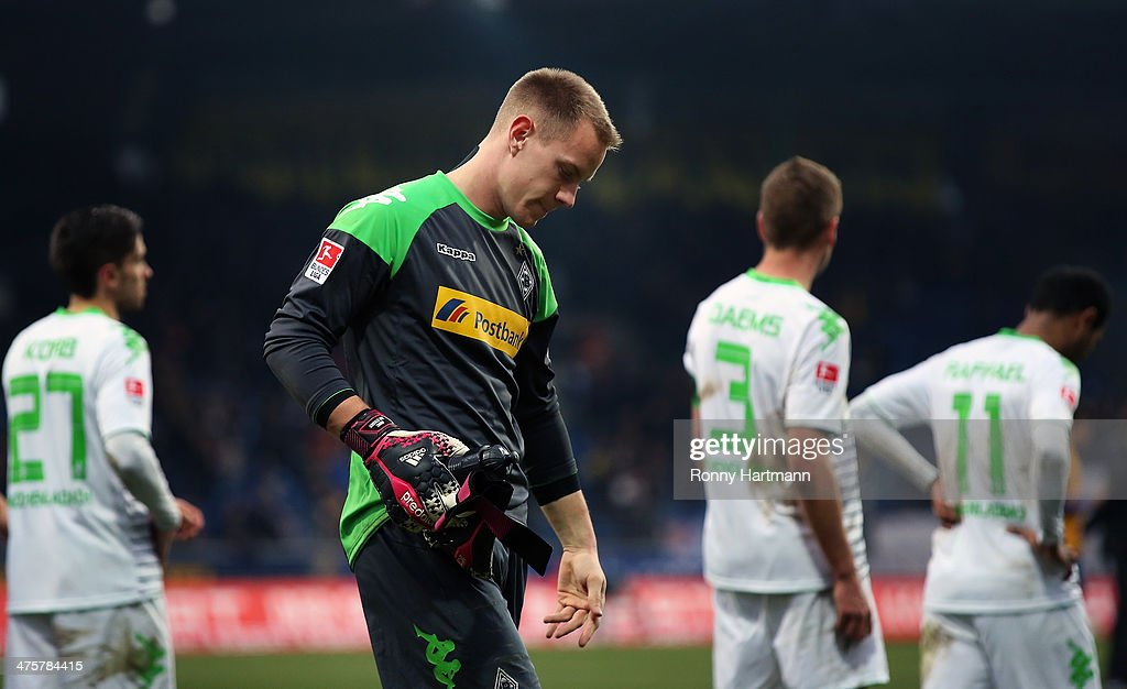 Goalkeeper <a gi-track='captionPersonalityLinkClicked' href=/galleries/search?phrase=Marc-Andre+ter+Stegen&family=editorial&specificpeople=5528638 ng-click='$event.stopPropagation()'>Marc-Andre ter Stegen</a> of Moenchengladbach looks dejected after the Bundesliga match between Eintracht Braunschweig and Borussia Moenchengladbach at Eintracht Stadion on March 1, 2014 in Braunschweig, Germany.