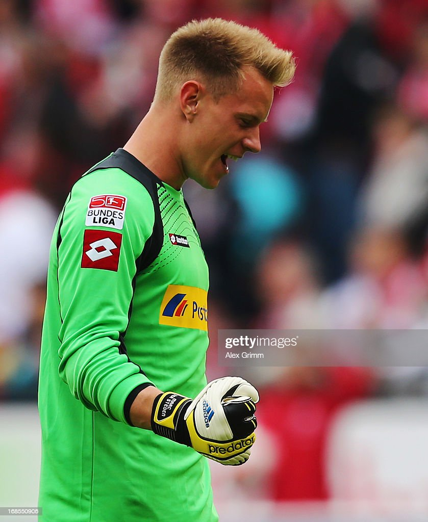 Goalkeeper <a gi-track='captionPersonalityLinkClicked' href=/galleries/search?phrase=Marc-Andre+ter+Stegen&family=editorial&specificpeople=5528638 ng-click='$event.stopPropagation()'>Marc-Andre ter Stegen</a> of Moenchengladbach reacts after team mate Branimir Hrgota scored his team's third goal during the Bundesliga match between 1. FSV Mainz 05 and VfL Borussia Moenchengladbach at Coface Arena on May 11, 2013 in Mainz, Germany.