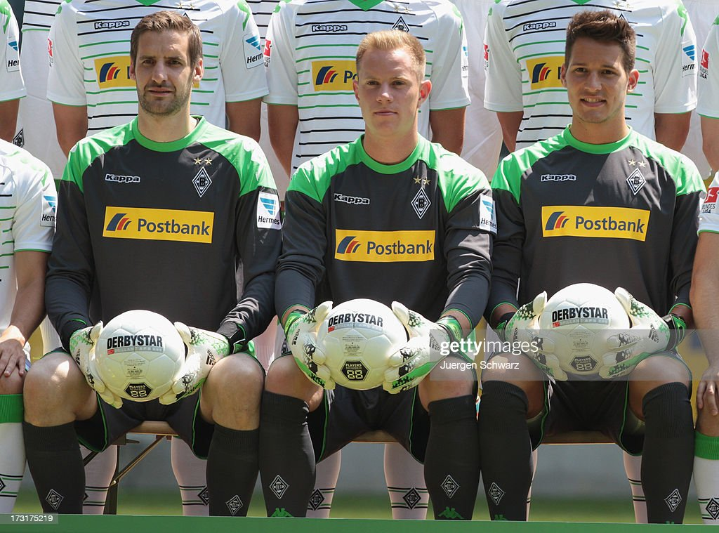 Goalkeeper Marc-Andre ter Stegen (C) sits between his deputies Christopher Heimeroth (L) and Janis Blaswich during the team presentation of Borussia Moenchengladbach on July 9, 2013 in Moenchengladbach, Germany.
