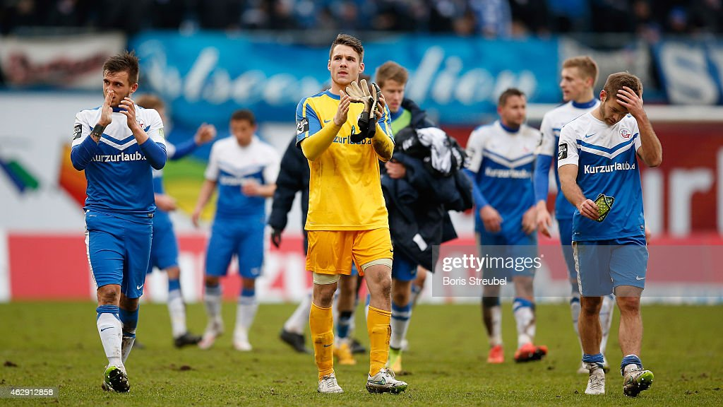 Goalkeeper Marcel Schuhen of Rostock and team mates react after the Third League match between Hansa Rostock and Jahn Regensburg at DKBArena on...