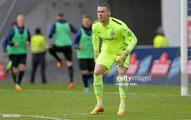 Goalkeeper Marcel Schuhen of Rostock looks on during the third league match between FC Hansa Rostock and 1FC Magdeburg at Ostseestadion on April 15...
