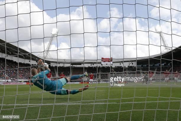 goalkeeper Marco Bizot of AZ saves penalty of Thierry Ambrose of NAC Breda during the Dutch Eredivisie match between AZ Alkmaar and NAC Breda at AFAS...