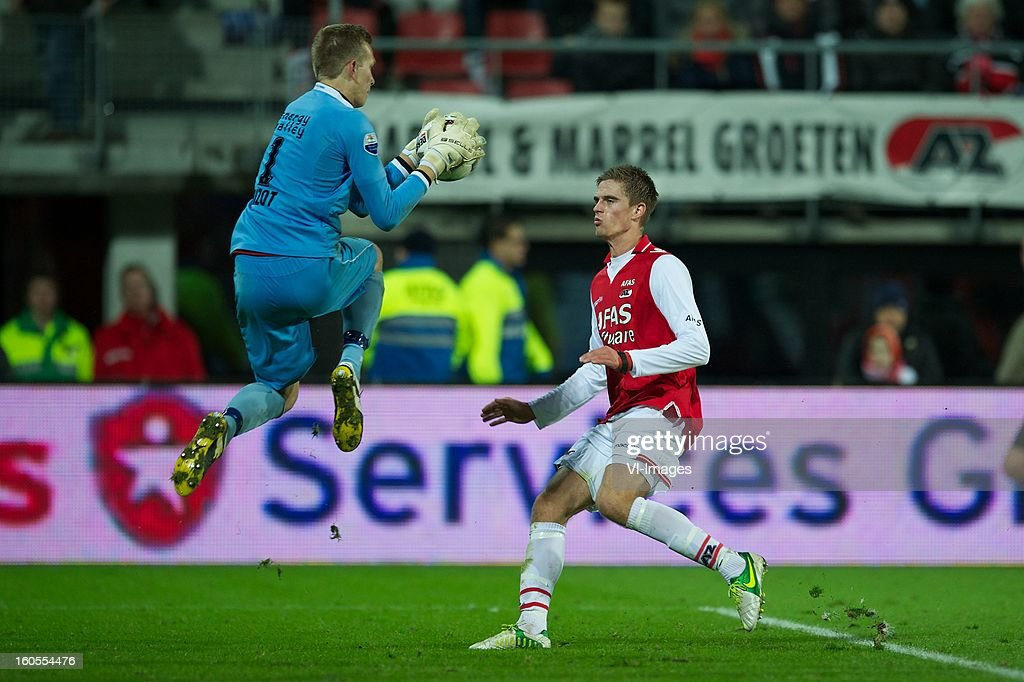 goalkeeper Marco Bizot of FC Groningen, Markus Henriksen of AZ during the Dutch Eredivisie match between AZ Alkmaar and FC Groningen at the AFAS Stadium on february 2, 2013 in Alkmaar, The Netherlands