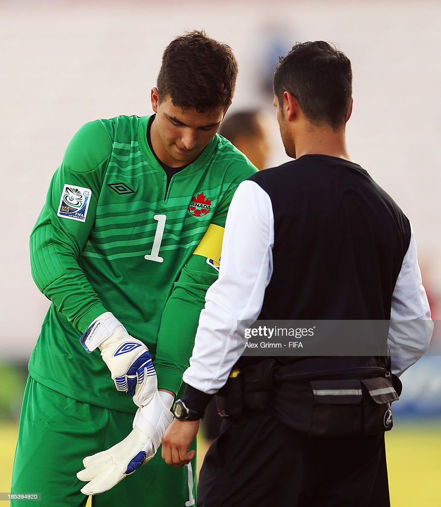 Goalkeeper Marco Carducci of Canada puts on his gloves prior to the FIFA U-17 World Cup UAE 2013 Group E match between Canada and Austria at Al Rashid Stadium on October 19, 2013 in Dubai, United Arab Emirates.