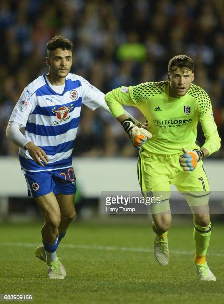 Goalkeeper Marcus Bettinelli of Fulham is marked by Tiago Ilori of Reading at a corner during the Sky Bet Championship Play Off Second Leg match...