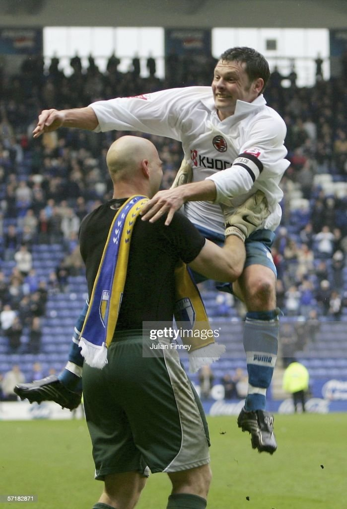 Goalkeeper Marcus Hahnemann celebrates with captain Graeme Murty of Reading after gaining promotion to the premiership after the CocaCola...
