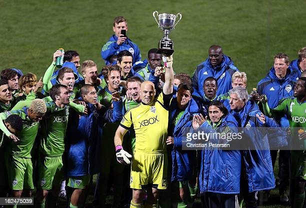 Goalkeeper Marcus Hahnemann of the Seattle Sounders holds up the FC Tucson Desert Diamond Cup alongside teammates after defeating Real Salt Lake 10...