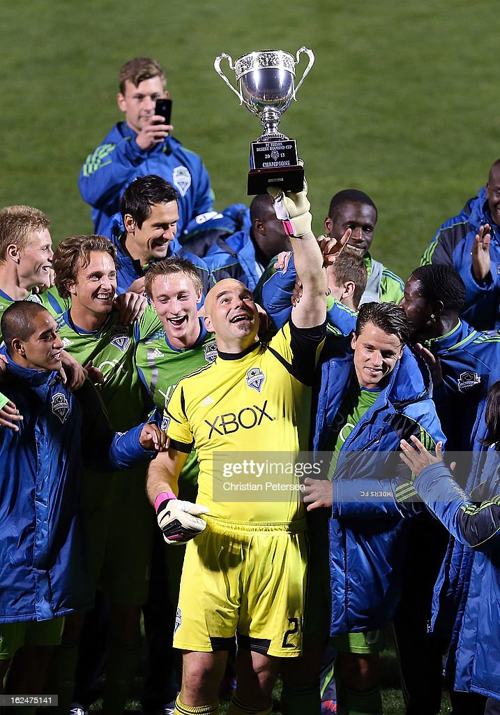 Goalkeeper <a gi-track='captionPersonalityLinkClicked' href=/galleries/search?phrase=Marcus+Hahnemann&family=editorial&specificpeople=593351 ng-click='$event.stopPropagation()'>Marcus Hahnemann</a> #24 of the Seattle Sounders holds up the FC Tucson Desert Diamond Cup alongside teammates after defeating Real Salt Lake 1-0 in the Championship match at Kino Sports Complex on February 23, 2013 in Tucson, Arizona.