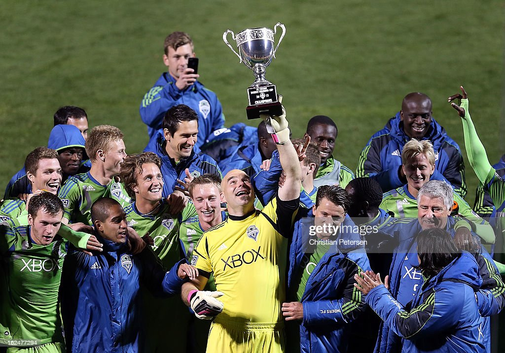 Goalkeeper Marcus Hahnemann #24 of the Seattle Sounders holds up the FC Tucson Desert Diamond Cup alongside teammates after defeating Real Salt Lake 1-0 in the Championship match at Kino Sports Complex on February 23, 2013 in Tucson, Arizona.