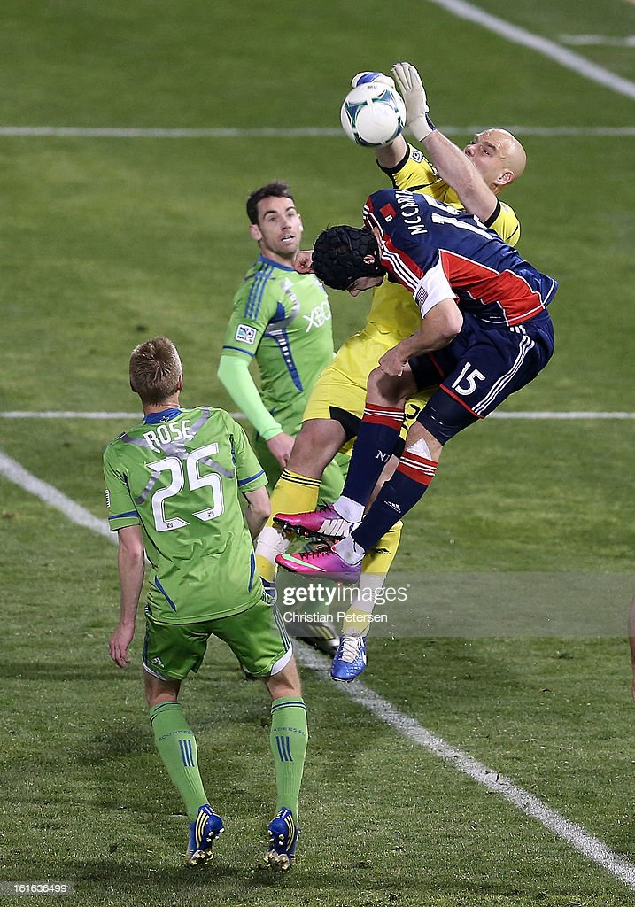 Goalkeeper <a gi-track='captionPersonalityLinkClicked' href=/galleries/search?phrase=Marcus+Hahnemann&family=editorial&specificpeople=593351 ng-click='$event.stopPropagation()'>Marcus Hahnemann</a> #24 of the Seattle Sounders makes a save as Stephen McCarthy #15 of the New England Revolution attempts a header during the second half of the FC Tucson Desert Diamond Cup at Kino Sports Complex on February 13, 2013 in Tucson, Arizona. The Sounders defeated the Revolution 2-0.