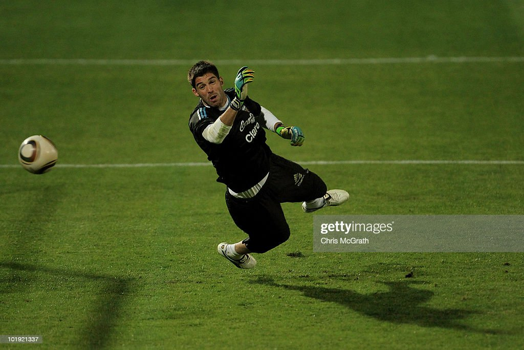 Goalkeeper <a gi-track='captionPersonalityLinkClicked' href=/galleries/search?phrase=Mariano+Andujar&family=editorial&specificpeople=804546 ng-click='$event.stopPropagation()'>Mariano Andujar</a> of Argentina's national football teamdives to make a save during a team training session on June 9, 2010 in Pretoria, South Africa.