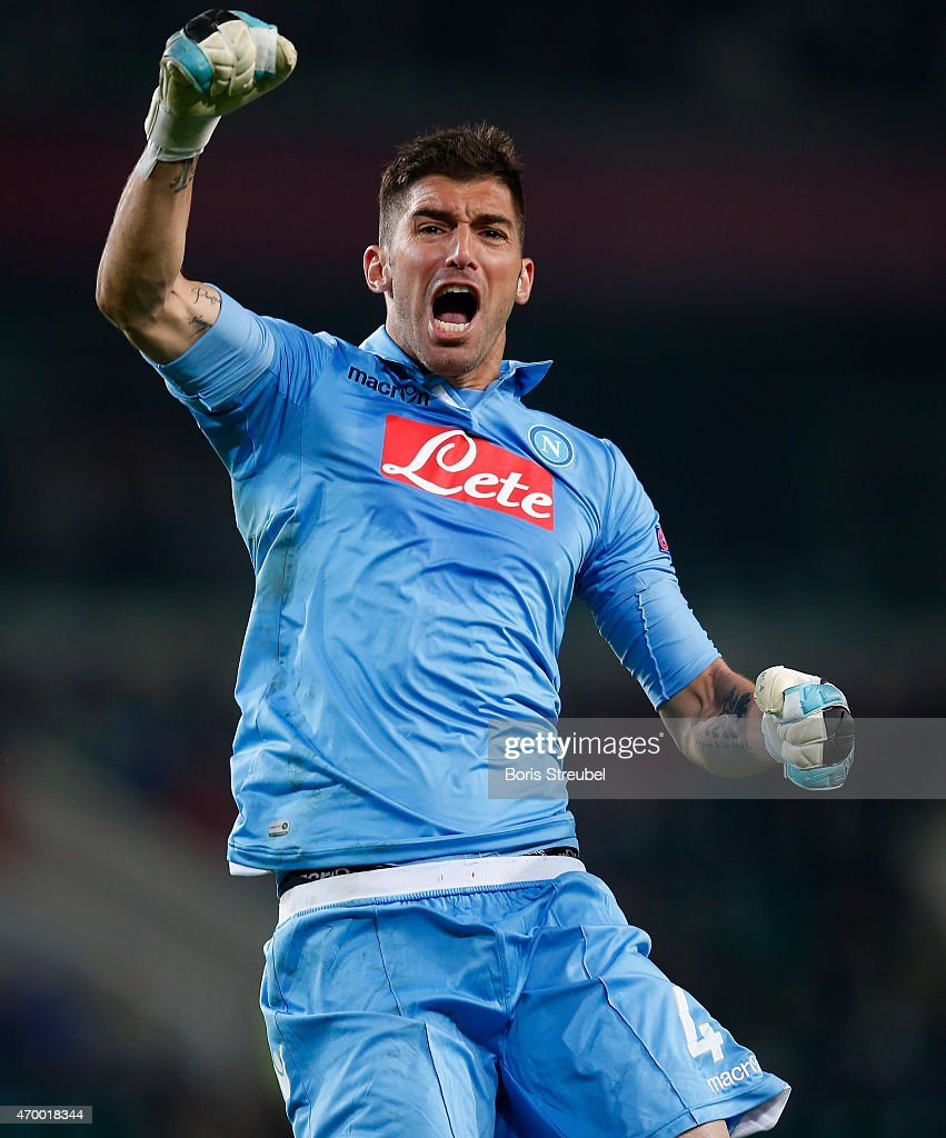 Goalkeeper <a gi-track='captionPersonalityLinkClicked' href=/galleries/search?phrase=Mariano+Andujar&family=editorial&specificpeople=804546 ng-click='$event.stopPropagation()'>Mariano Andujar</a> of Napoli celebrates during the UEFA Europa League Quarter Final first leg match between VfL Wolfsburg and SSC Napoli at Volkswagen Arena on April 16, 2015 in Wolfsburg,